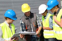 construction crew reviewing information on site